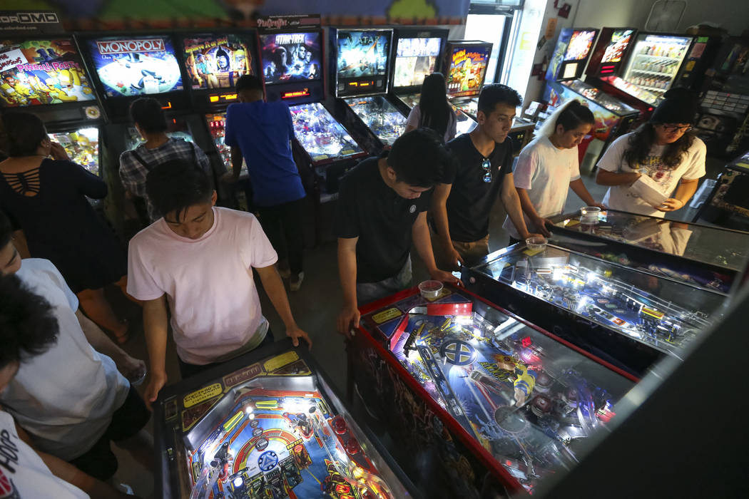 Patrons crowd a row of pinball machines at the Pinball Hall of Fame located at 1610 E. Tropican ...