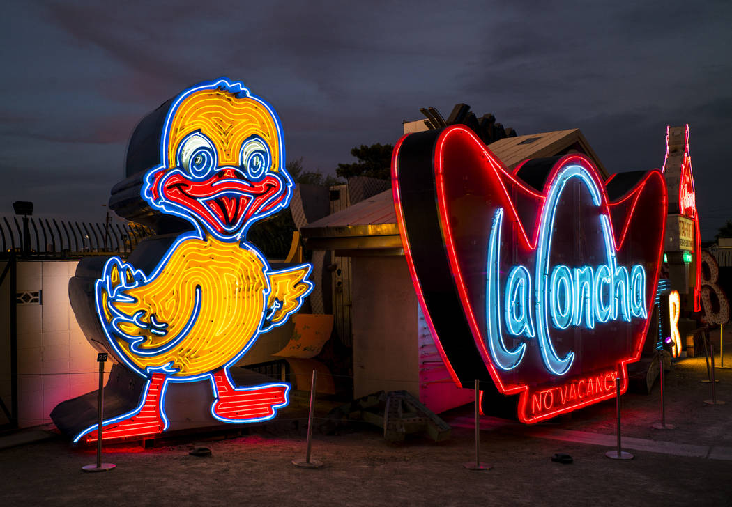 The recently restored Ugly Duckling sign stands next to the La Concha sign at the Neon Museum i ...
