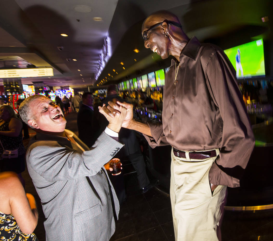 """George Bell, who stands 7'8"""", talks with Derek Stevens, owner of The D Las Vegas, at the L ..."""