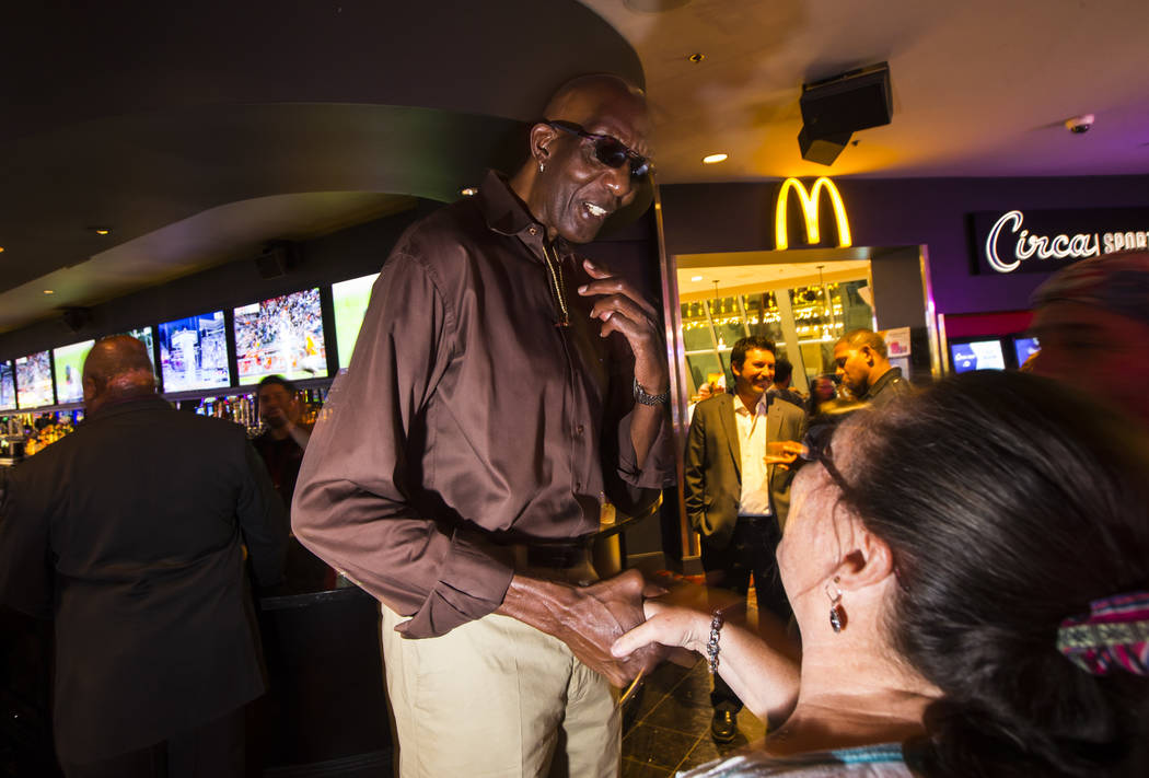 """George Bell, who stands 7'8"""", greets onlookers while hanging out at the Longbar at The D L ..."""