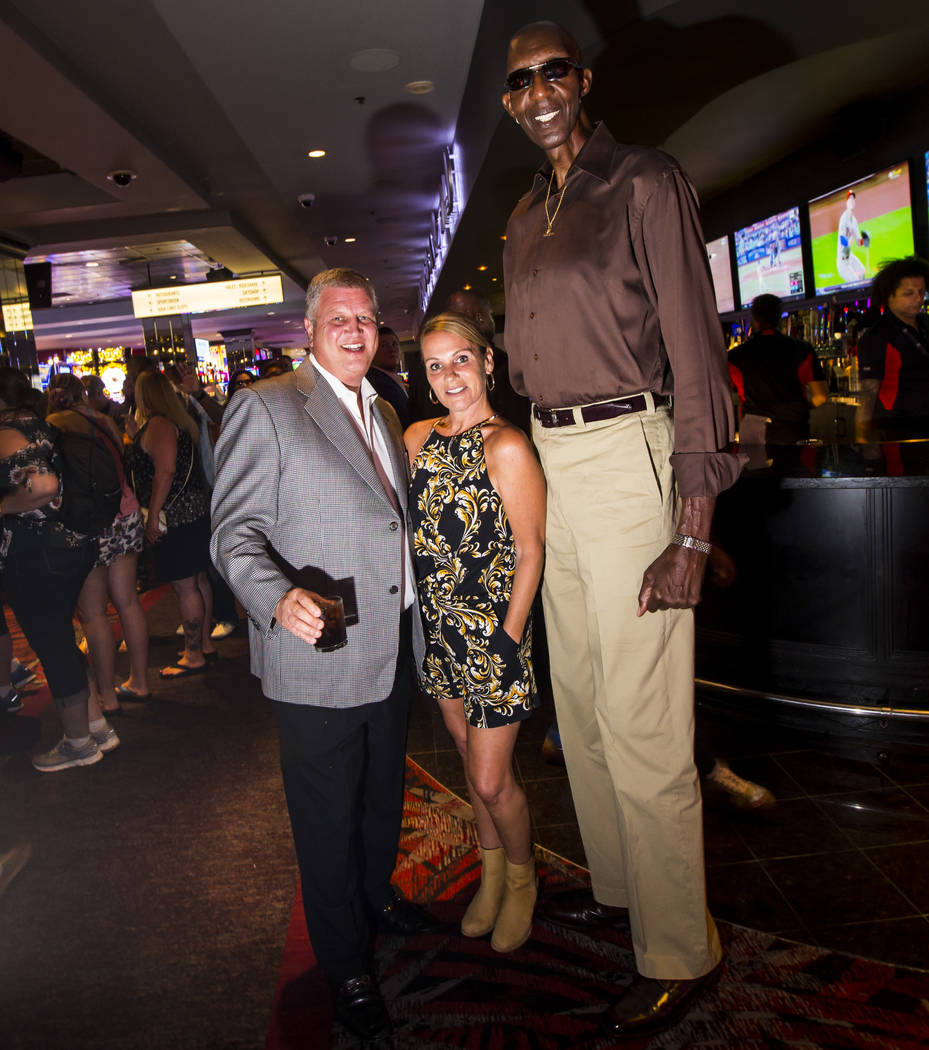 """George Bell, who stands 7'8"""", poses for a portrait with Derek Stevens, owner of The D Las ..."""