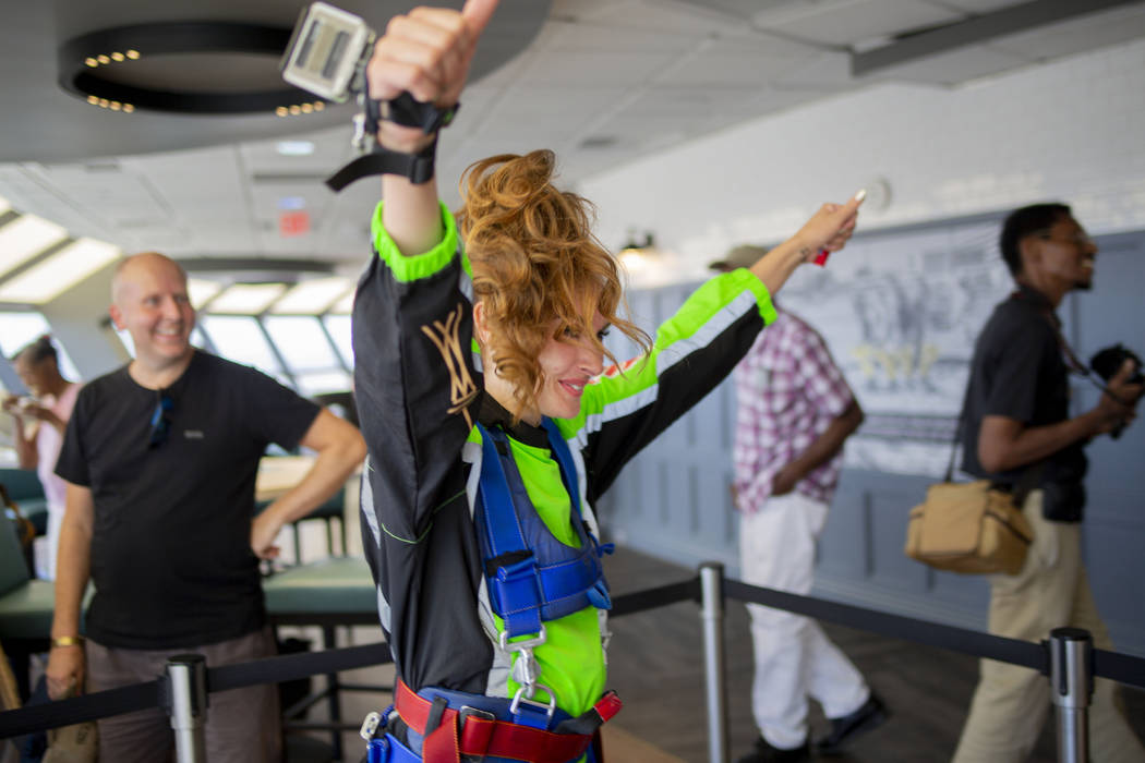 Annie Woolley, England, gets prepared to SkyJump at the Strat in Las Vegas, Thursday, Aug. 1, 2 ...