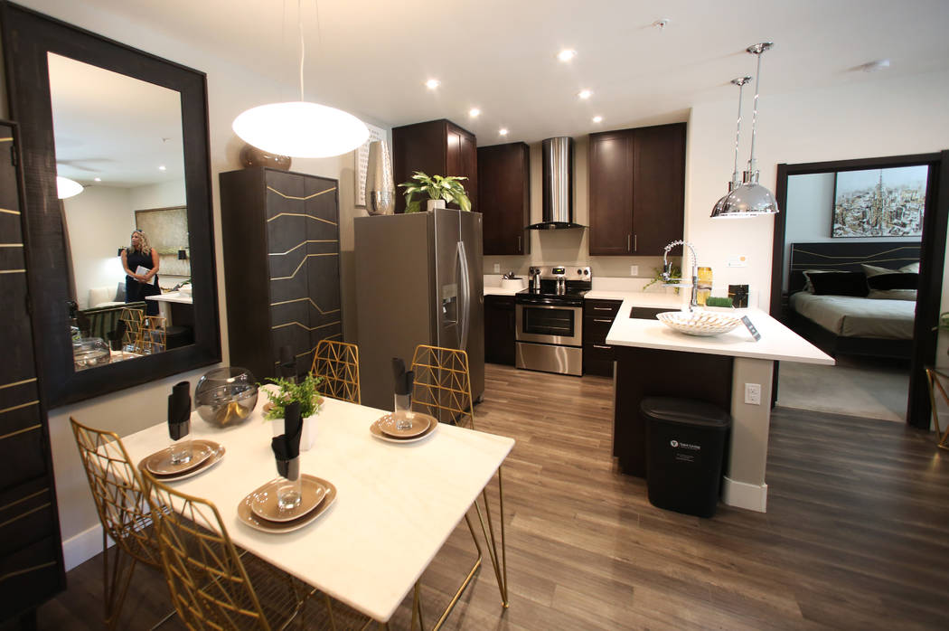 Dining area, a kitchen and a master bedroom are seen at Empire apartment complex is seen on Fri ...