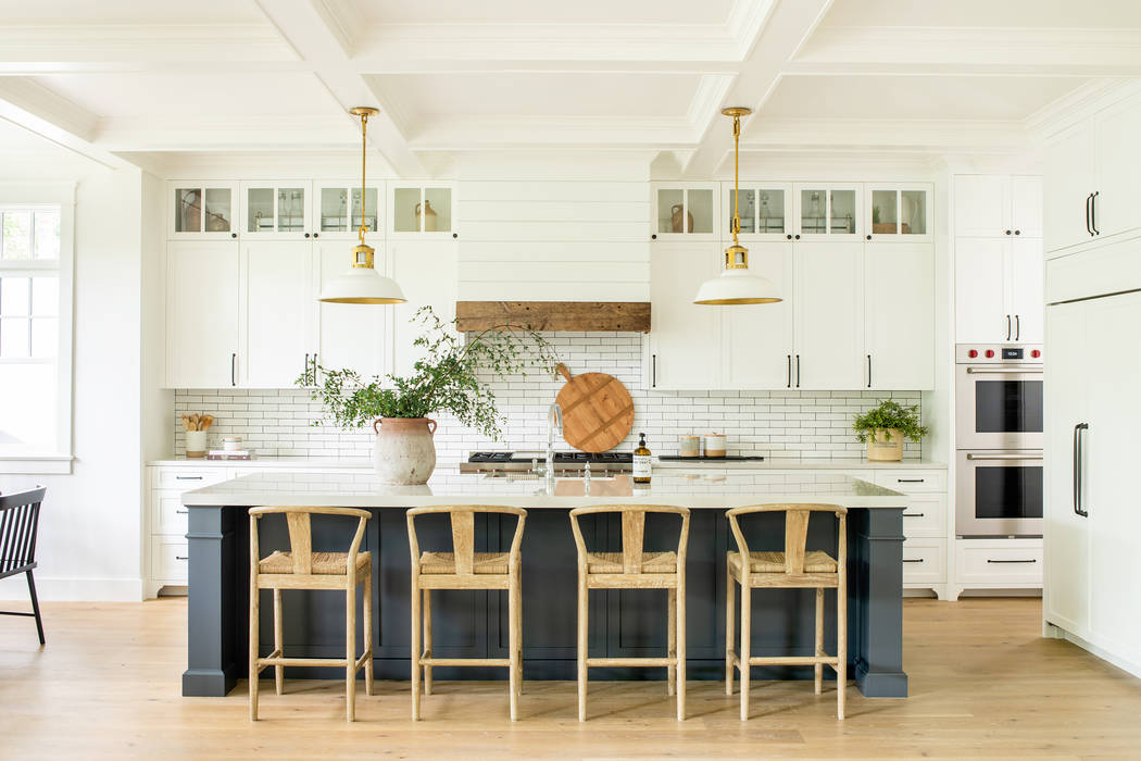 The kitchen is the hub of the house where people congregate. An interactive island provides a p ...
