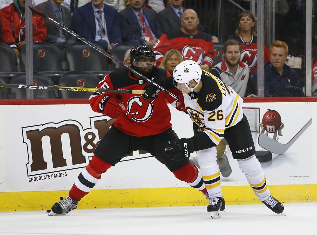 New Jersey Devils defenseman P.K. Subban (76) battle Boston Bruins center Par Lindholm (26) for ...