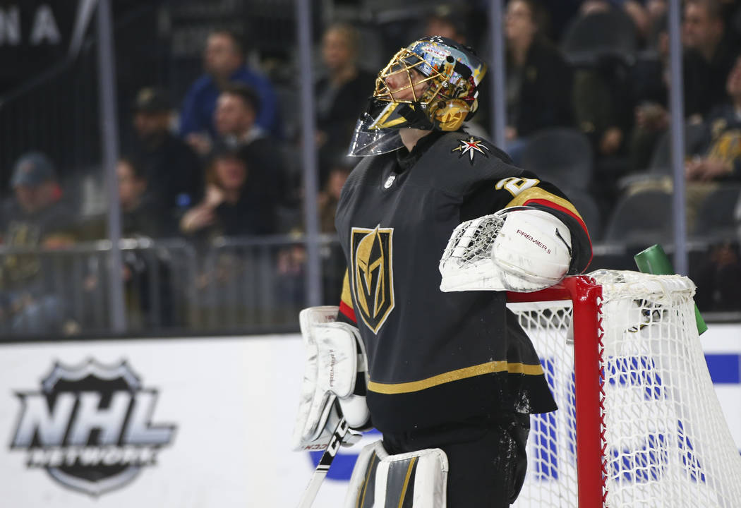 Golden Knights goaltender Marc-Andre Fleury (29) reacts after giving up a goal to the Arizona C ...