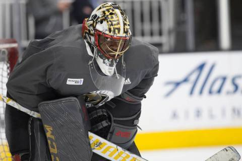 Golden Knights goaltender Malcolm Subban (30) peers out of his mask during practice on Thursday ...