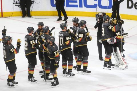 Golden Knights right wing Alex Tuch (89) celebrates a shutout victory with goaltender Malcolm S ...
