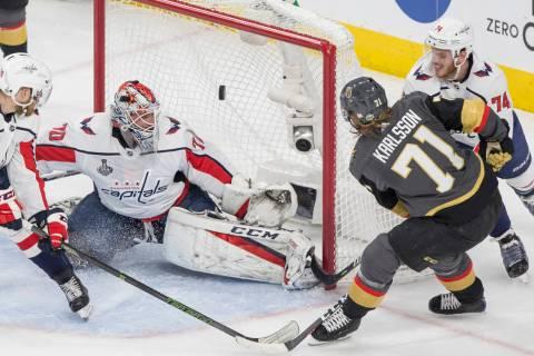 Golden Knights center William Karlsson (71) scores a first-period goal against Capitals goalten ...