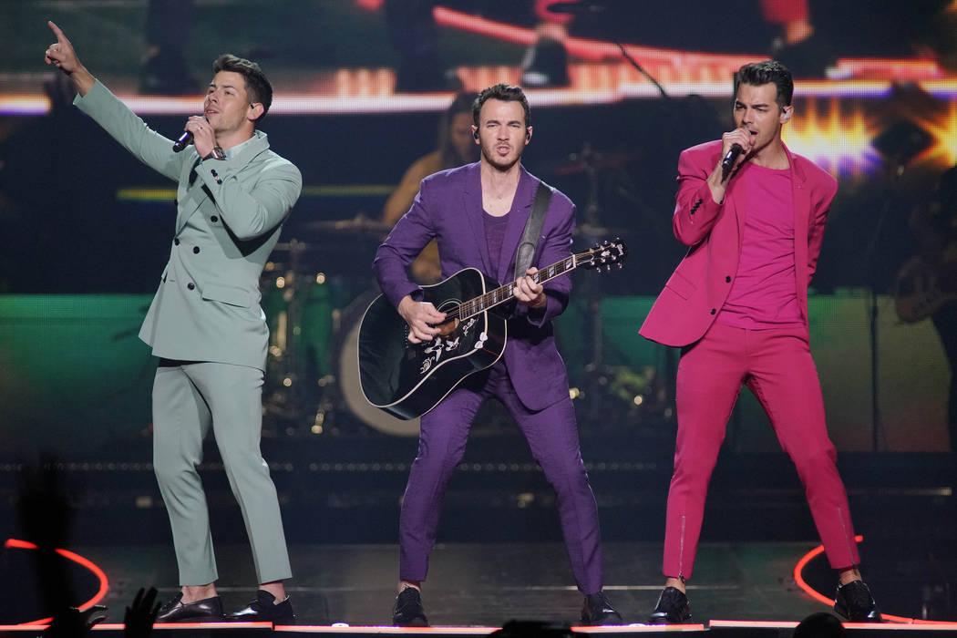 Nick Jonas, from left, Kevin Jonas, and Joe Jonas, of the Jonas Brothers, perform during their ...