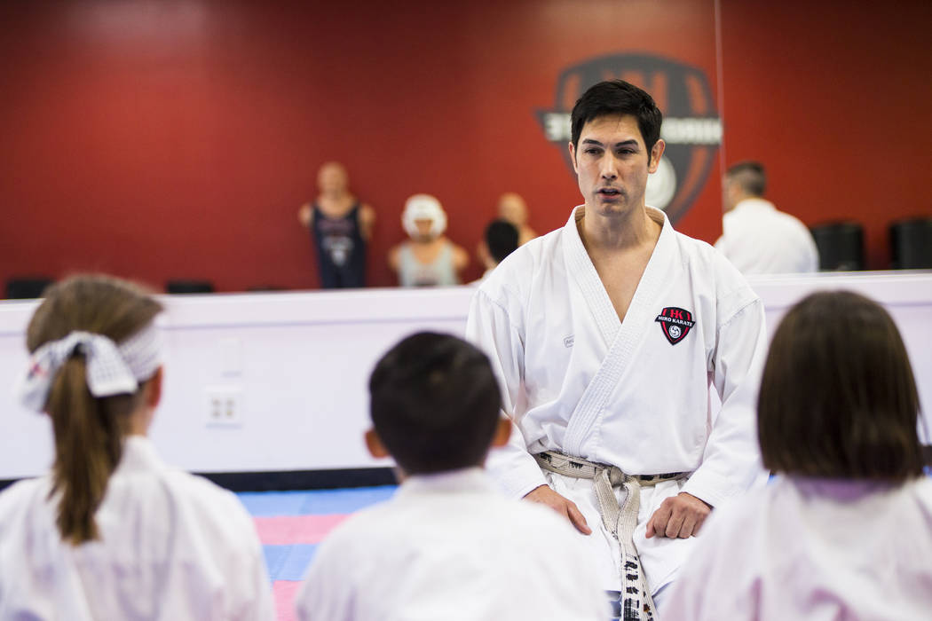 Hiroshi Allen talks with students about positive speech and thinking during a class at Hiro Kar ...