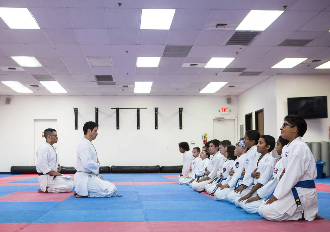 Hiroshi Allen leads students in a breathing technique during a class at Hiro Karate in Las Vega ...