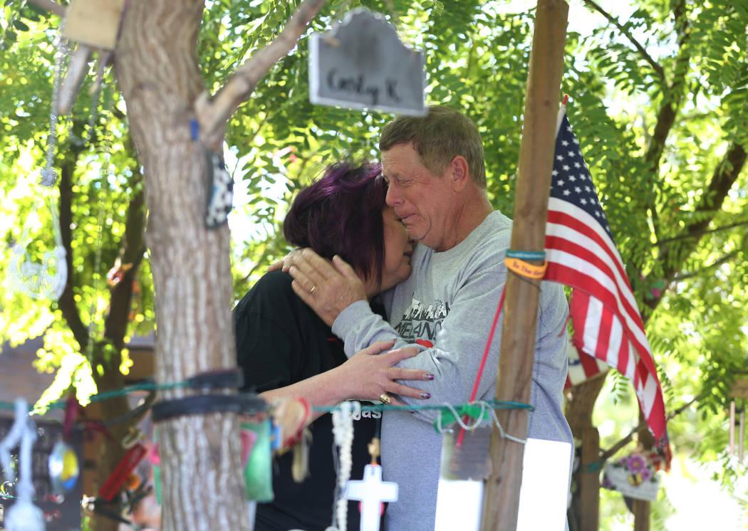 Oct. 1 shooting survivor Rosemarie Melanson, 55, and her husband Steve, 61, comfort each other ...
