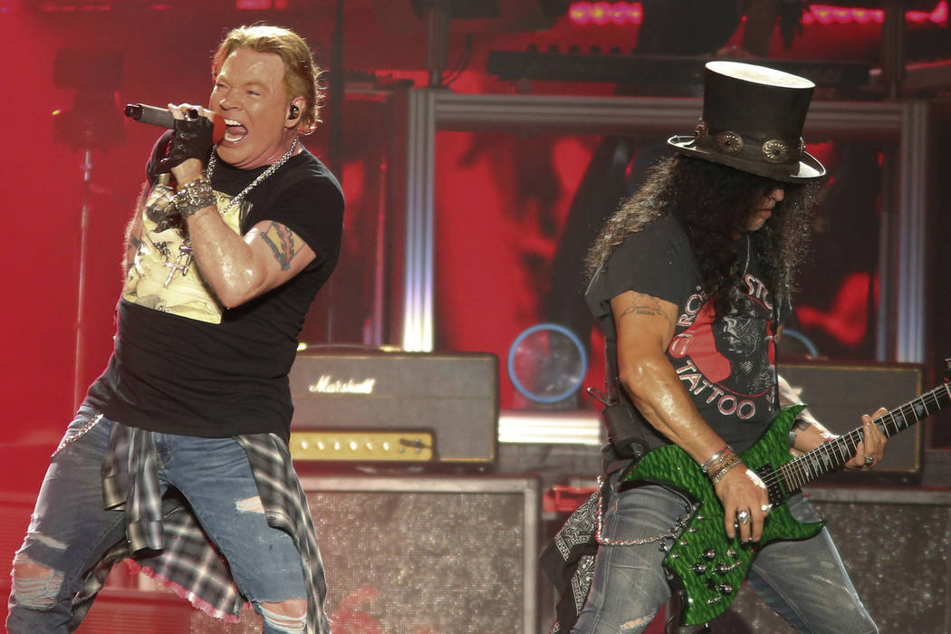Guns N' Roses' Axl Rose, left, and Slash perform on the first weekend of the Austin City Limits ...
