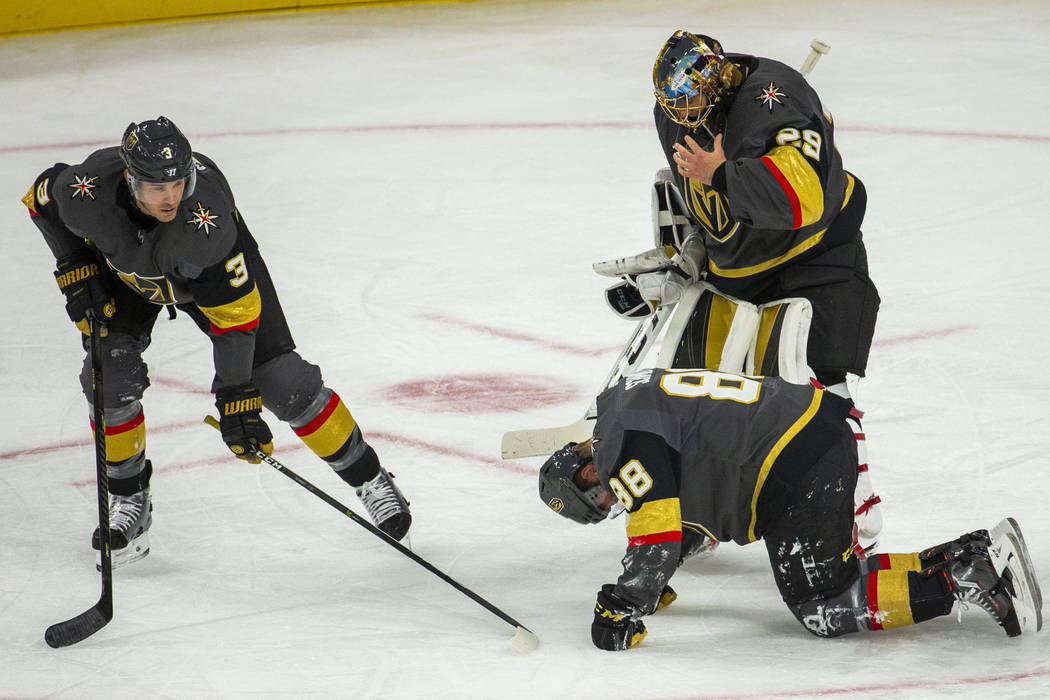 Vegas Golden Knights defenseman Nate Schmidt (88) is down injured on the ice versus the San Jos ...