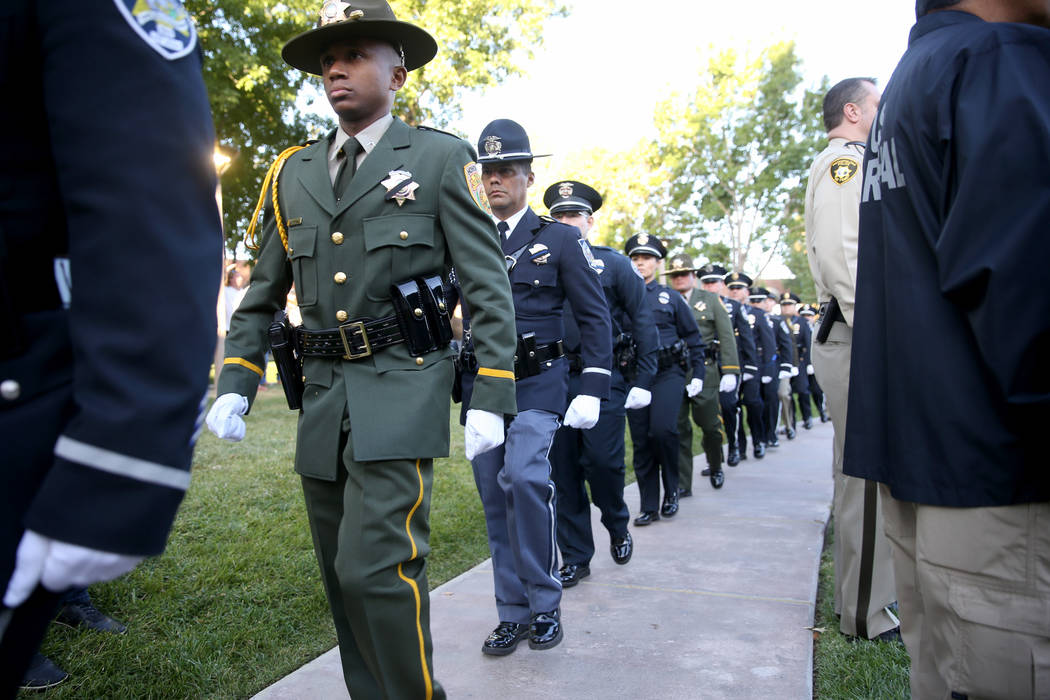 Members of the honor guard at the Clark County Government Center amphitheater in Las Vegas Tues ...