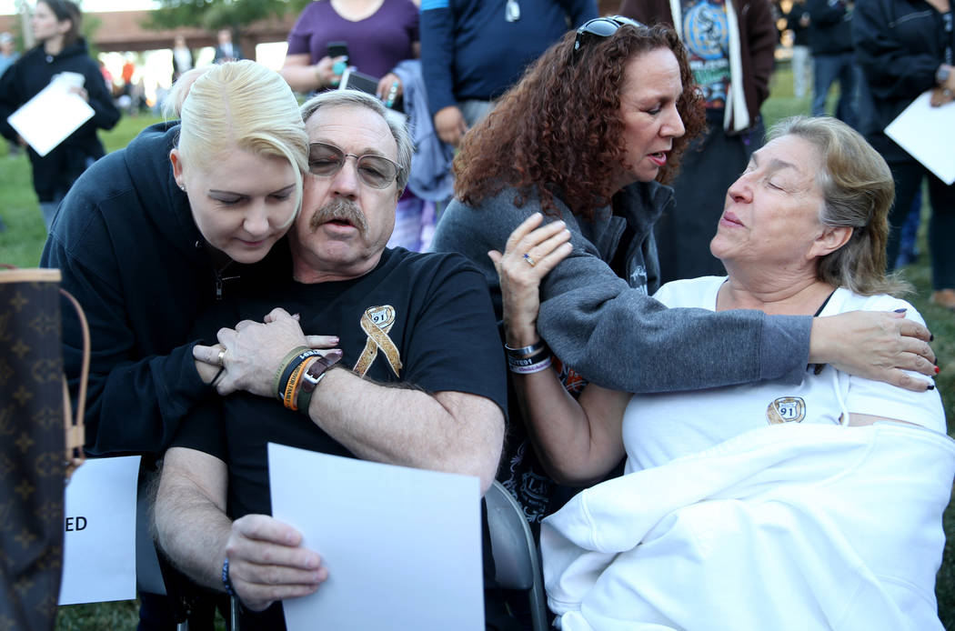 Adriane Geggie, left, of Irvine, Calif. hugs Steve Darling as Michelle Eisenberg of Chino Hills ...