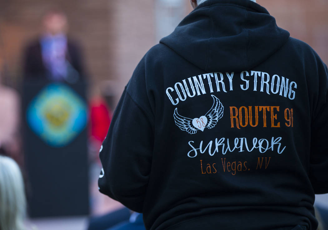 A Route 91 Harvest festival survivor listens during a sunrise ceremony in remembrance of the 58 ...
