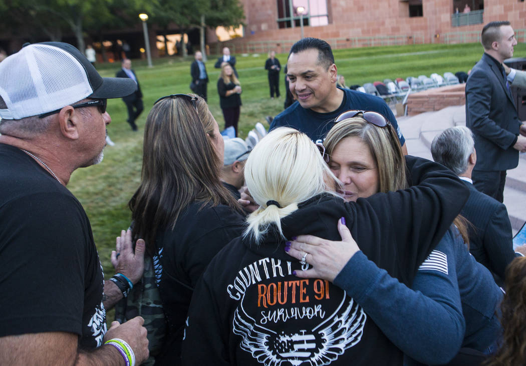 Mary Rivera, mother of Jordyn Rivera, who died in the Route 91 Harvest festival, right, embrace ...