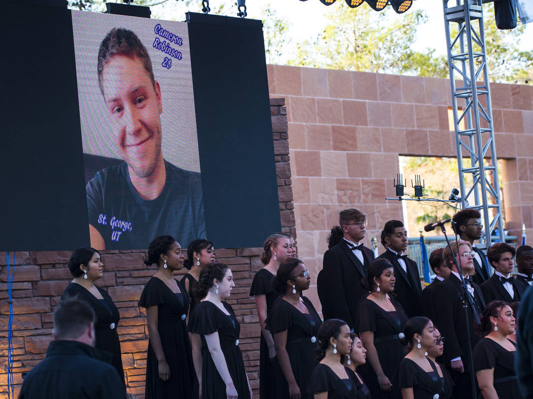 A photo of Route 91 Harvest festival victim Cameron Robinson is displayed during a sunrise cere ...