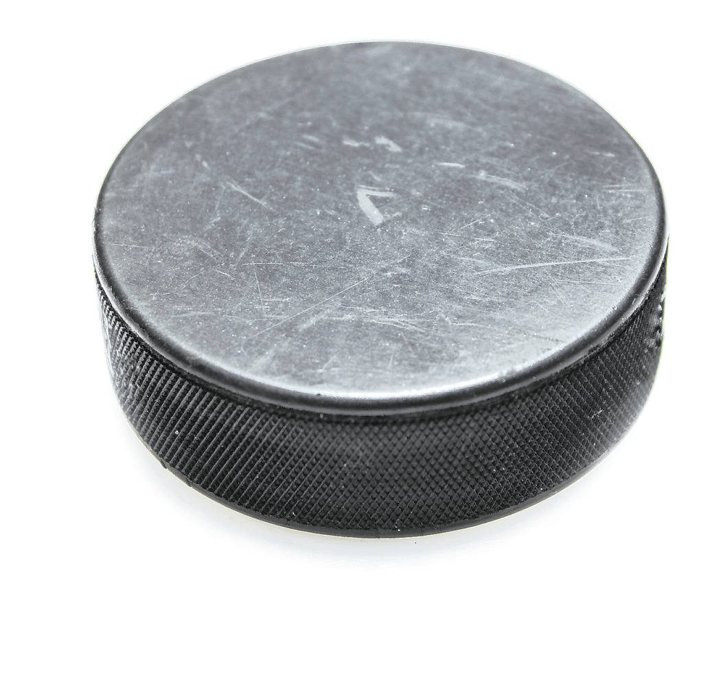 A hockey puck on a white background