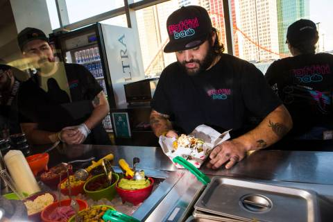 Graffiti Bao and Pina Nachos owner and chef Marc Marrone prepares nachos before the start of a ...