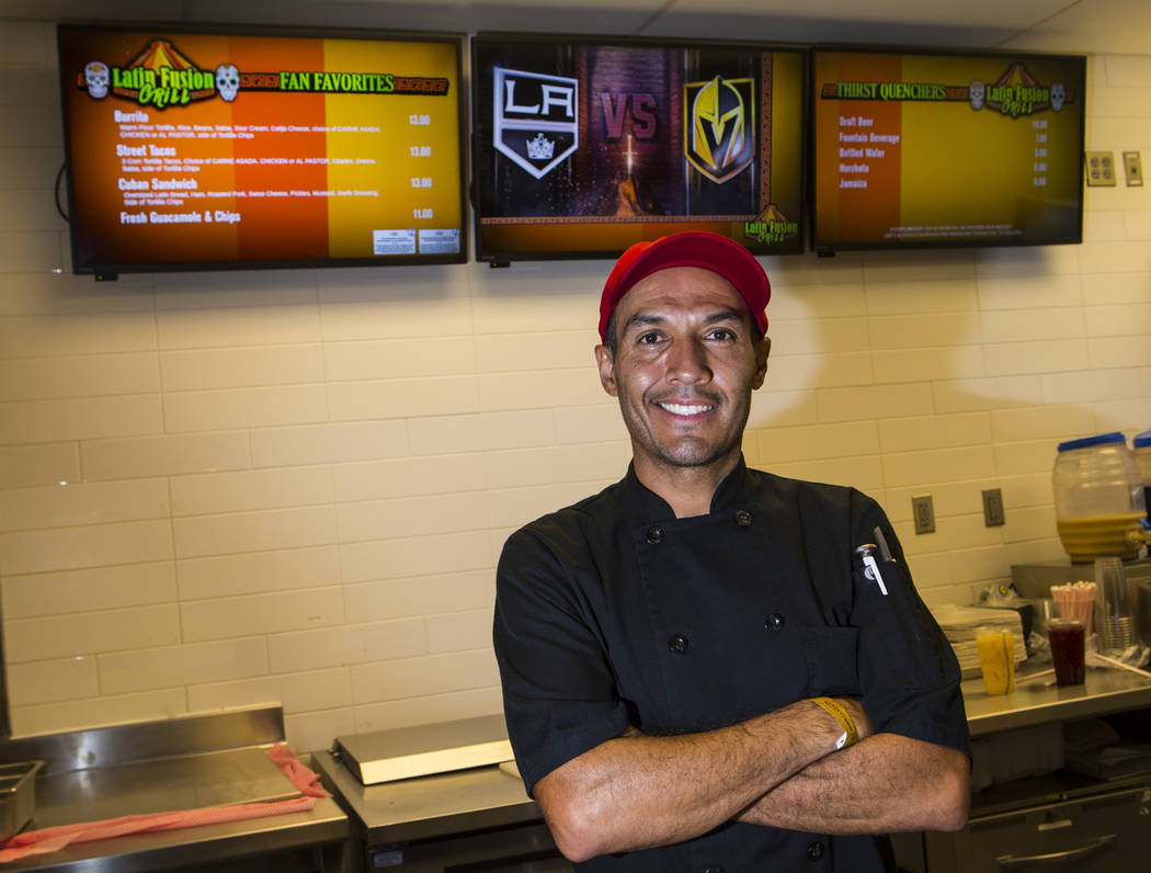Latin Fusion Grill owner and chef Ernesto Saavedra poses for a portrait before the start of a G ...