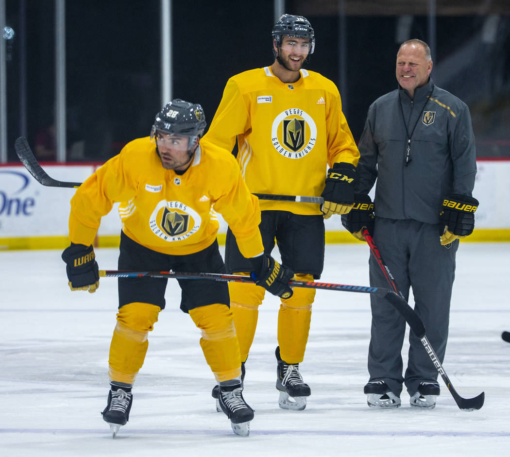 Vegas Golden Knights left wing William Carrier (28, left) and center Nicolas Roy (10) stand wit ...