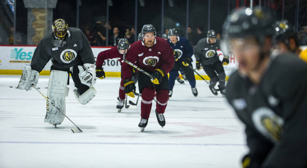 Vegas Golden Knights players skate around the ice as the team honors first responders, Mandalay ...