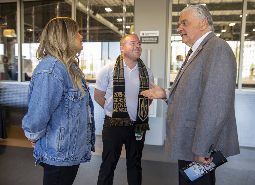 Gov. Steve Sisolak, right, chats with Todd Pollock and his daughter Carley as the Vegas Golden ...