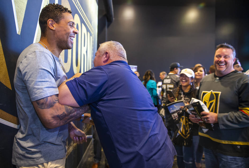 The Vegas Golden Knights Ryan Reaves, left, is playfully checked by Bob Byrd with Community Amb ...