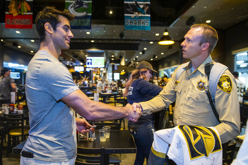 The Vegas Golden Knights Max Pacioretty, left, shakes hands with Las Vegas police detective Mik ...