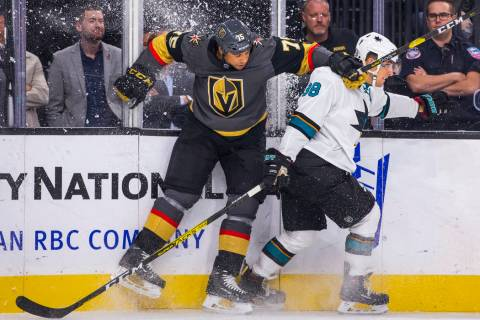 Vegas Golden Knights right wing Ryan Reaves (75) checks the boards with San Jose Sharks defense ...