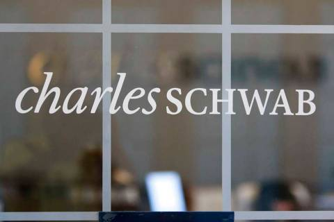 A July 14, 2010, file photo, shows a Charles Schwab office in Oakland, Calif. Charles Schwab is ...