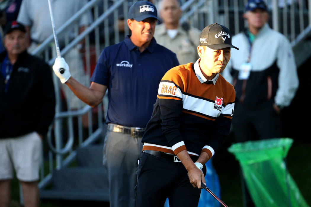 Kevin Na, right, and Phil Mickelson watch Na's tee shot on the 10th hole during Shriners Hospit ...