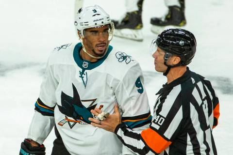 San Jose Sharks left wing Evander Kane (9) argues with a referee after fighting with Vegas Gold ...