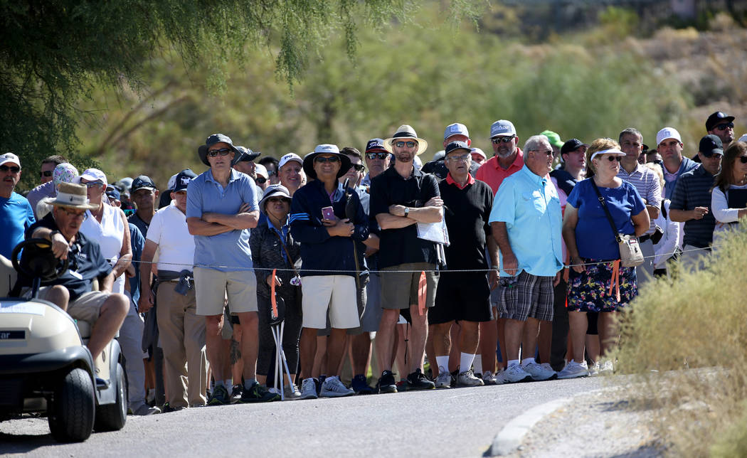 Fans watch Phil Mickelson, Tony Finau and Kevin Na, on the sixth hole during Shriners Hospitals ...