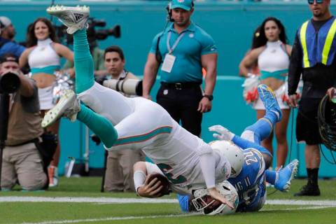 Los Angeles Chargers defensive back Desmond King (20) tackles Miami Dolphins quarterback Josh R ...