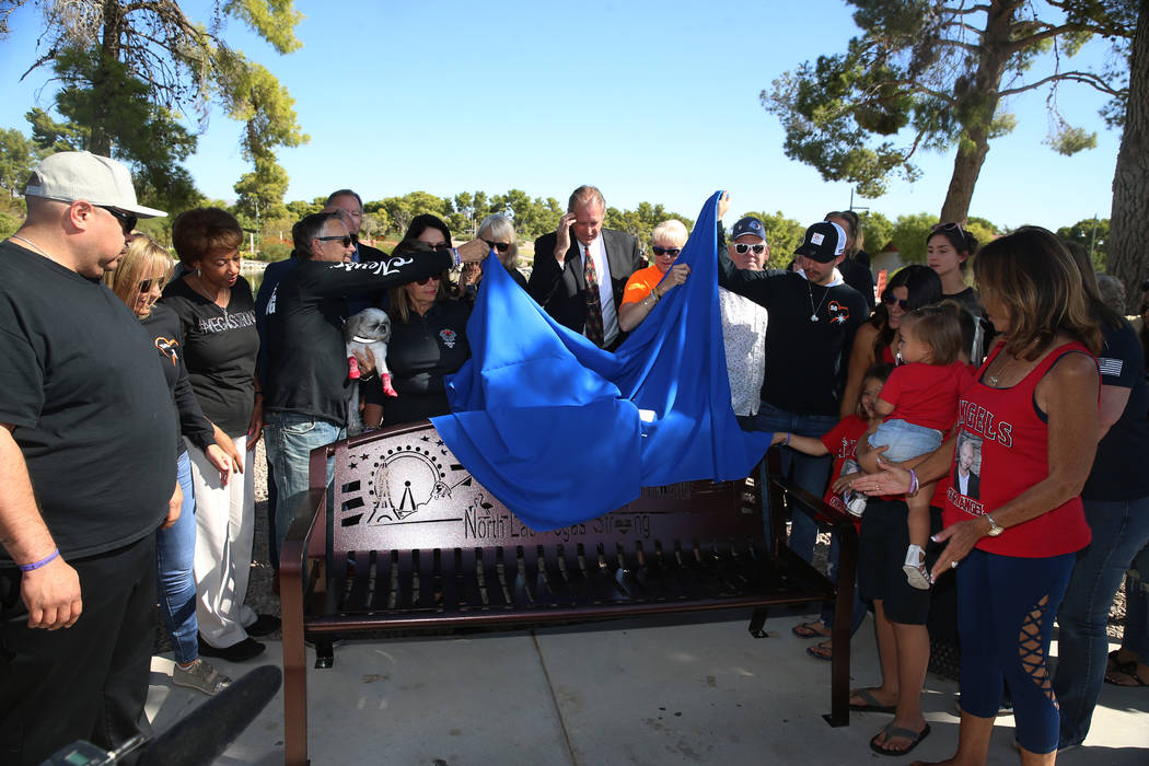 Attendees unveiled a bench in tribute to the 58 victims of the Route 91 Harvest festival during ...