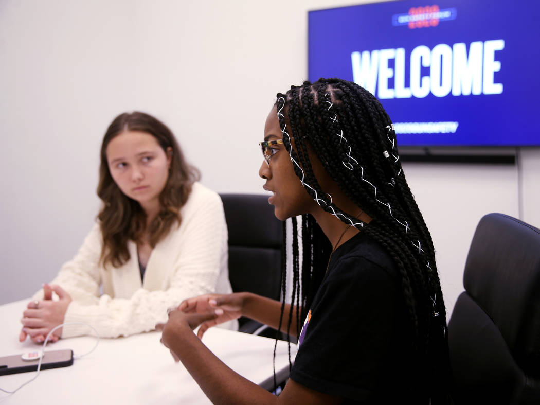 Lauren Hogg, 16, of Parkland Fla., left, and Ariel Hobbs, 21, of Houston, talk to a reporter in ...