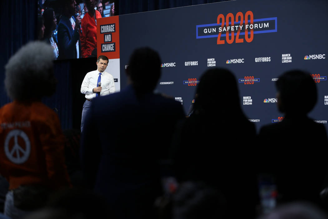 Democratic presidential candidate Pete Buttigieg takes a question from the audience during the ...