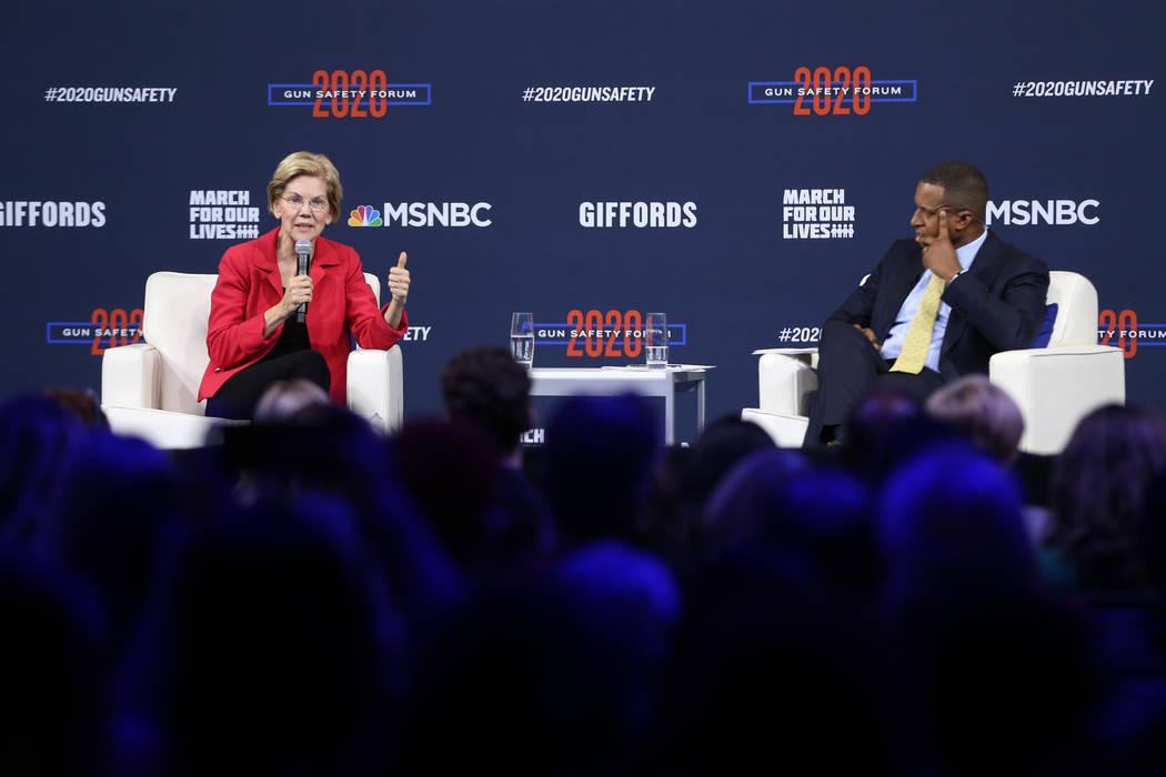 Democratic presidential candidate Elizabeth Warren, left, with forum host and journalist Craig ...