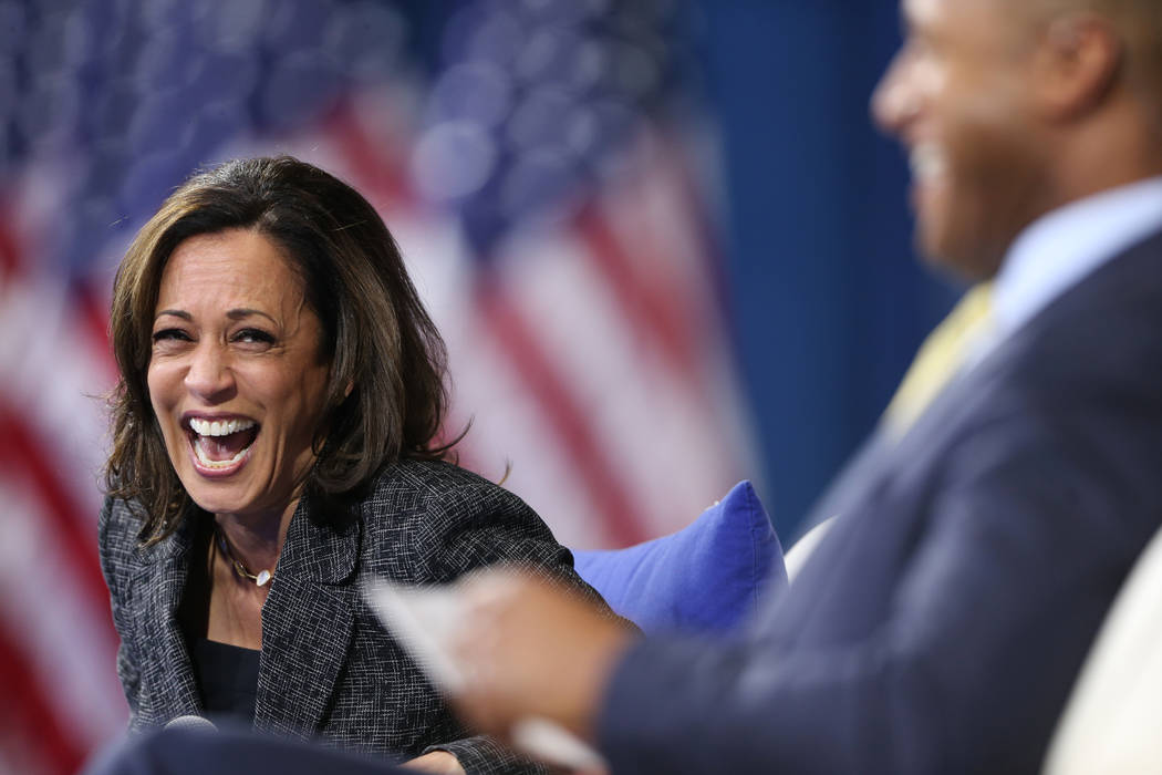 Democratic presidential candidate Kamala Harris, left, shares a laugh with forum host and journ ...
