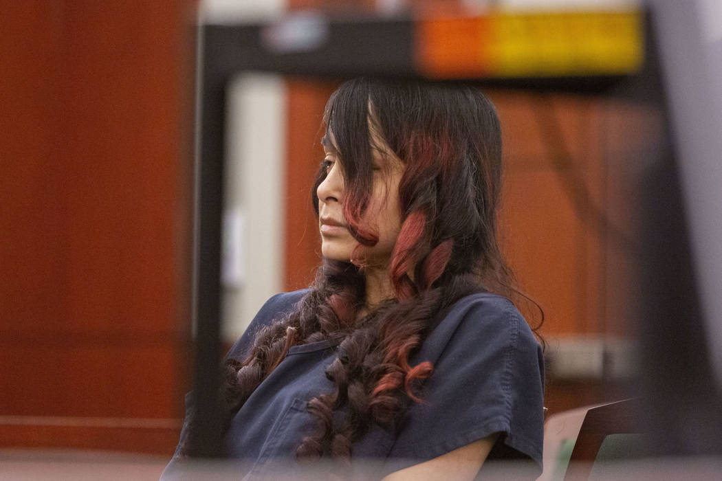Gigi Mitchell, accused of trafficking an 11-year-old girl, appears in court during her sentenci ...