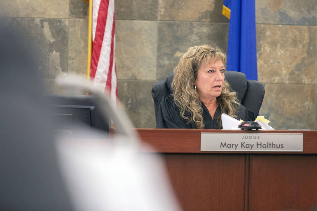 Judge Mary Kay Holthus speaks during Gigi Mitchell's sentencing at the Regional Justice Center ...