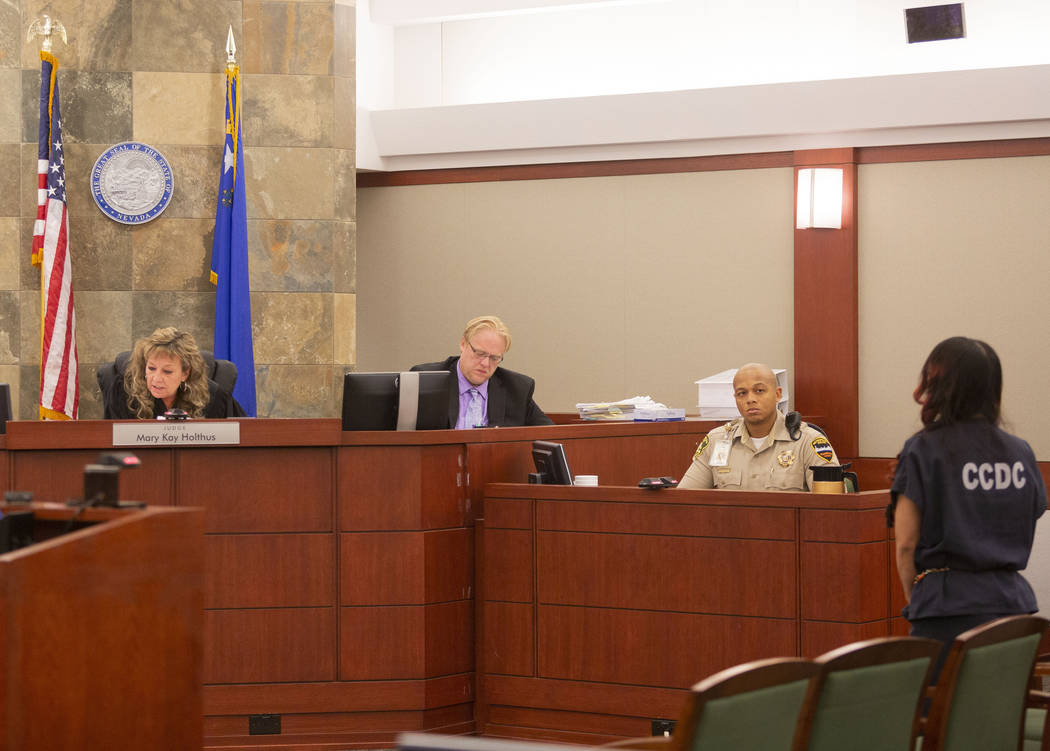 Gigi Mitchell, right, accused of trafficking an 11-year-old girl, stands in front of Judge Mary ...