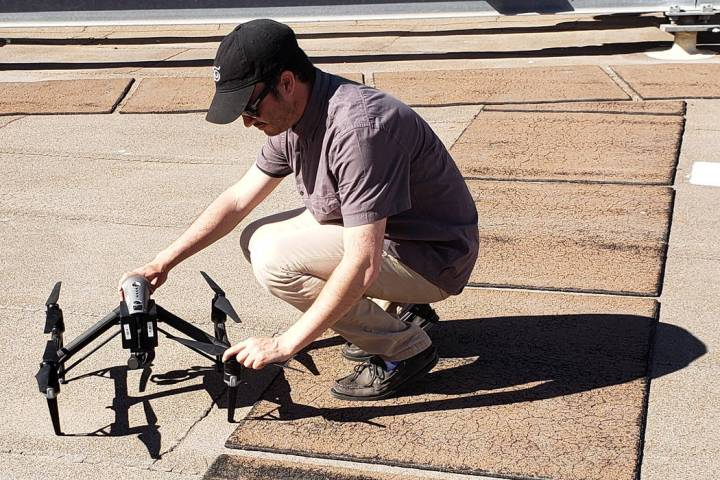 """Las Vegas resident Trace Dantzig positions a drone in March 2019 during filming for CBS' """"T ..."""