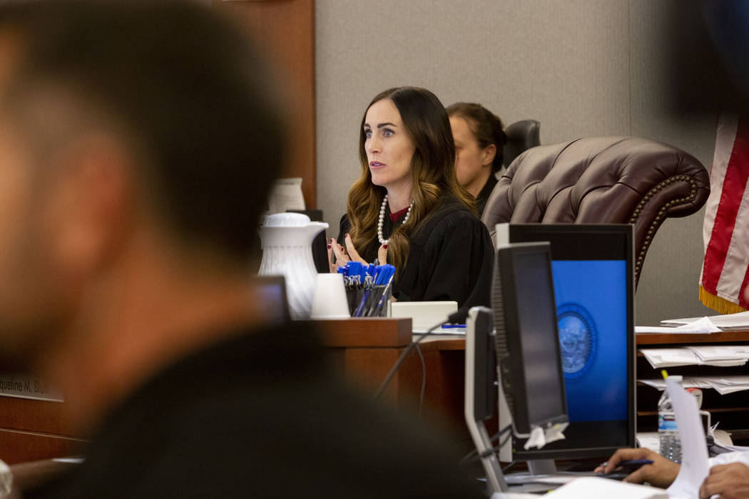 Clark County District Judge Jacqueline Bluth presides over a hearing for Ashley Fargo and Henry ...