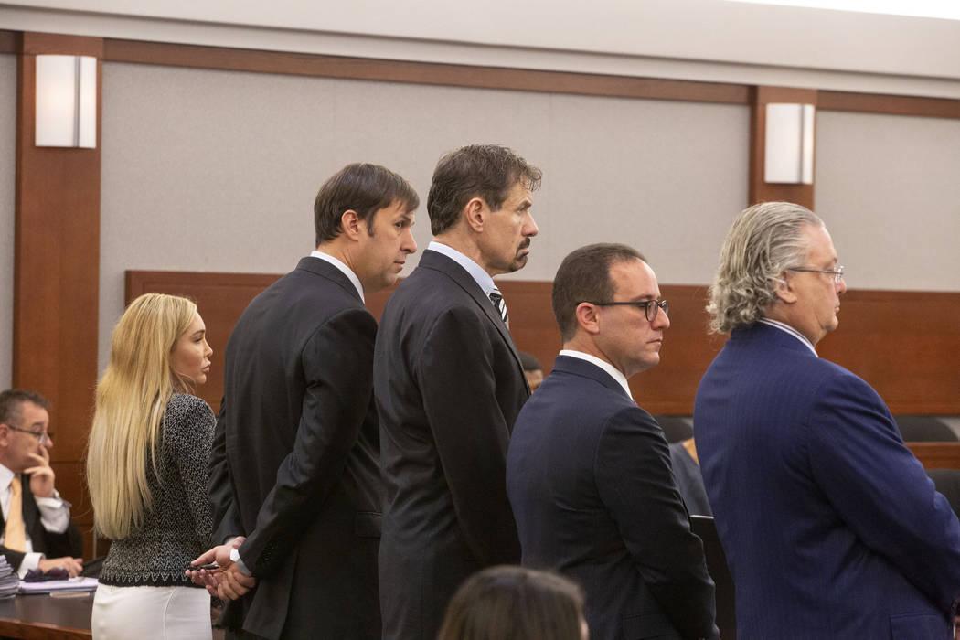 From left, Ashley Fargo, defense attorney David Brown, Henry Nicholas III and attorneys Richard ...
