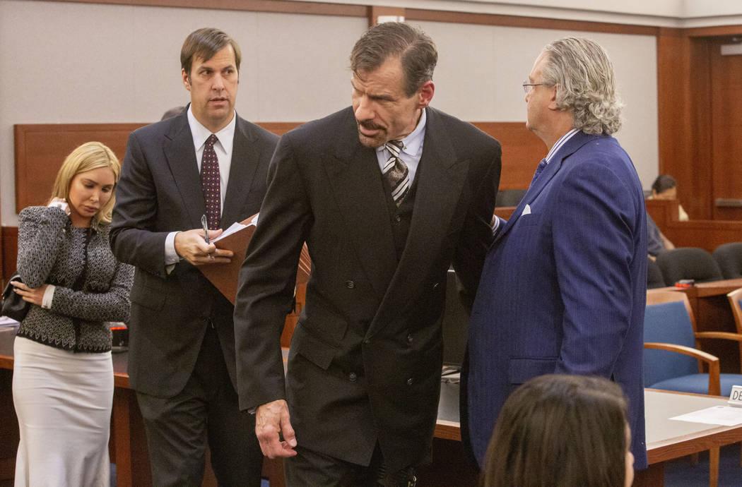 Ashley Fargo, defense attorney David Brown, Henry Nicholas III and defense attorney David Chesn ...